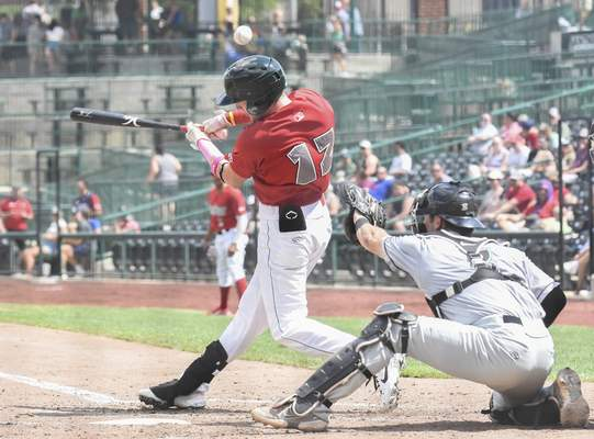 Michelle Davies | The Journal Gazette The TinCaps' Robert Hassell III hits a foul ball during the third inning Sunday. He made his TinCaps debut Sunday.