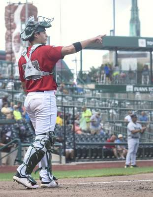 Michelle Davies | The Journal Gazette TinCaps' Brandon Valenzuela calls out the count in the fourth inning of Sunday's game against Dayton at Parkview Field.