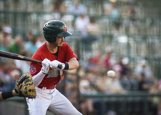 Mike Moore | The Journal Gazette TinCaps left fielder Grant Little eyes the pitch Saturday in the second inning Dayton at Parkview Field on Saturday.