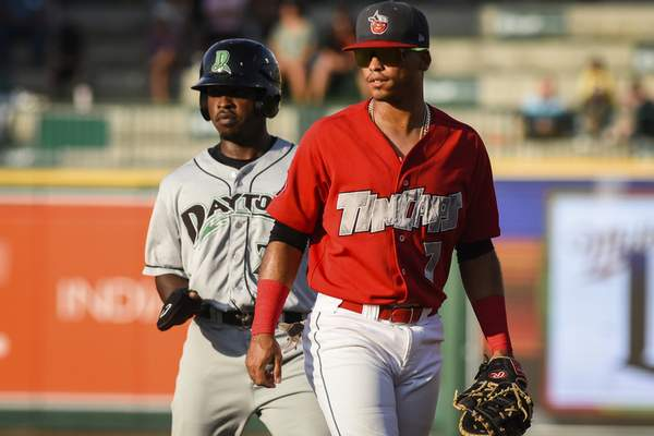 Mike Moore | The Journal Gazette TinCaps first baseman Luis Almanzar, right guards the bag against Dragons second baseman Ivan Johnson in the first inning on Saturday.