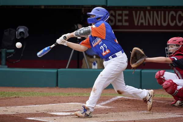 Associated Press Jackson Surma of Taylor, Mich., hits a two-run double in the first inning of the Little League World Series championship game on Sunday. Surma drove in four runs to lead the Michigan team.