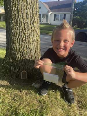 Courtesy Kindergartner Lennon Moord has developed a pen pal relationship with five elves who apparently live in a tree in his neighborhood. Lennon leaves the elves notes, and they write back.