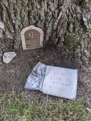 Along with letters, the elves who have taken up residence in a tree in the Frances Slocum neighborhood have left Lennon stickers and a book.