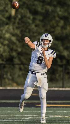 Mike Moore | The Journal Gazette Trine quarterback Alex Price passes the ball in the first quarter against Manchester on Thursday.