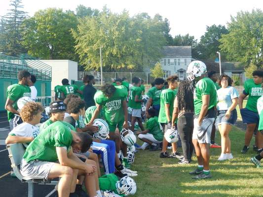 Victoria Jacobsen  The South Side football players take a break during practice on Wednesday afternoon.