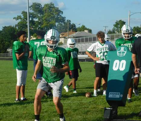 Victoria Jacobsen  South Side senior Trevor Hapner runs through a drill with a tackling sled at practice on Wednesday afternoon.