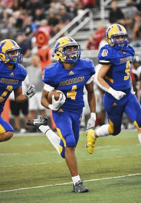 Katie Fyfe | The Journal Gazette  Homestead senior Desmond Smith runs toward the end zone during the second quarter against Bishop Luers at Homestead High School on Friday.