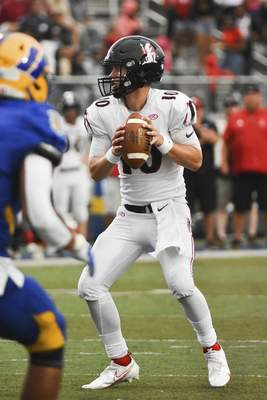 Katie Fyfe | The Journal Gazette  Bishop Luers junior Carson Clark looks to pass during the second quarter against Homestead at Homestead High School on Friday.