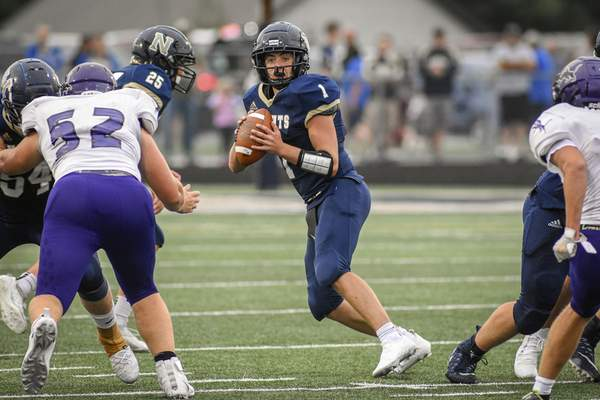 Mike Moore | The Journal Gazette Norwell quarterback Lleyton Bailey looks for a receiver in the first quarter against Leo in Ossian on Friday.