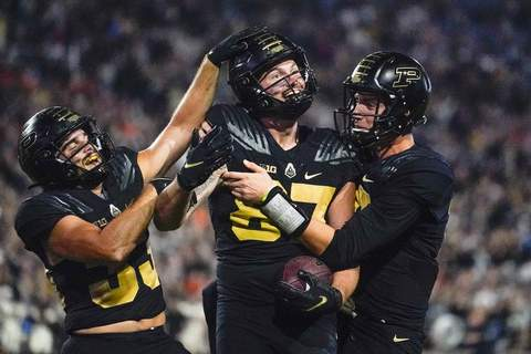 Oregon St Purdue Football Purdue tight end Payne Durham (87) celebrates a touchdown with wide receiver Jackson Anthrop, left, and quarterback Jack Plummer , right, during the second half of an NCAA college football game Oregon State in West Lafayette, Ind., Saturday, Sept. 4, 2021. (AP Photo/Michael Conroy) (Michael Conroy STF)
