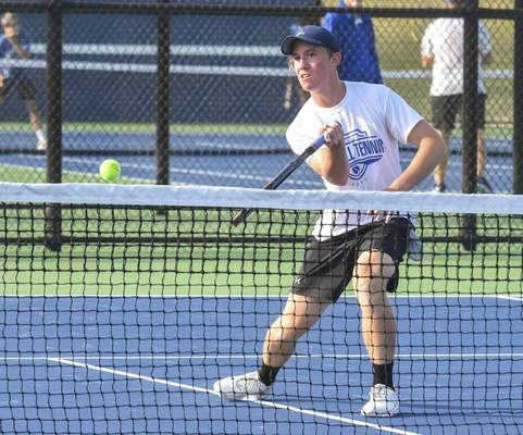 Michelle Davies | The Journal Gazette Carroll's Griffin Martin returns the ball during his match at Saturday's Carroll Invitational.