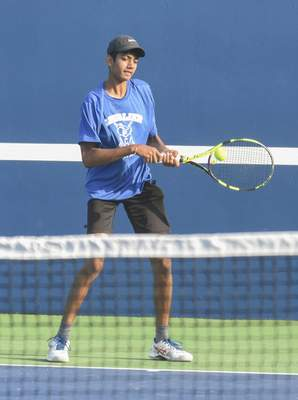 Michelle Davies | The Journal Gazette Canterbury's Roshen Kulkarni concentrates as he returns the ball during his match at Saturday's Carroll Invitational.