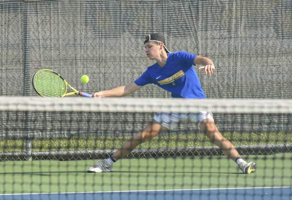 Michelle Davies | The Journal Gazette Homestead's Stephen Meier reaches to return the ball during his match at Saturday's Carroll Invitational.
