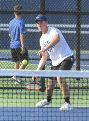 Michelle Davies | The Journal Gazette Carroll's Griffin Martin concentrates as he returns the ball during his match at Saturday's Carroll Invitational.