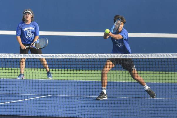 Michelle Davies | The Journal Gazette Canterbury's James Lewis, right, returns the ball with partner Oliver VandeWater, keeps an eye on the play during their match at Saturday's Carroll Invitational.