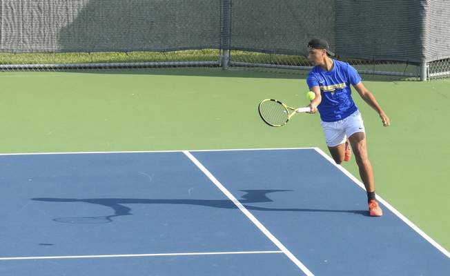 Michelle Davies | The Journal Gazette Homestead's Alex Graber returns the ball during his doubles match at Saturday's Carroll Invitational.
