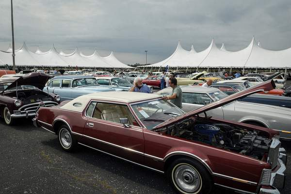 Photos by Mike Moore | The Journal Gazette Hundreds of cars were to cross the auction block this weekend at the Auburn Fall Auction.