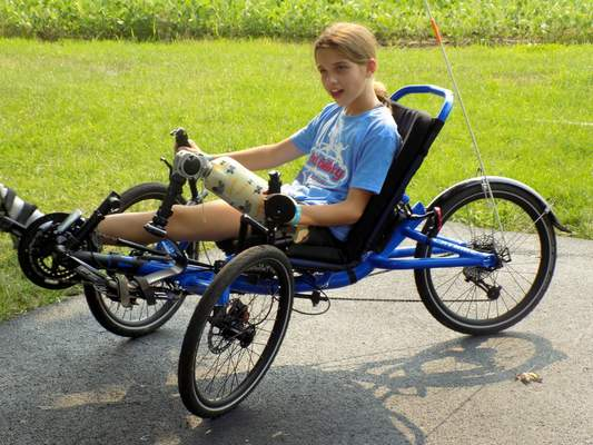 Blake Sebring | For The Journal Gazette Cami, a Blackhawk Christian student, lost her left leg to a developmental disorder when she was 7 years old. Now 11, she uses a prosthetic to try multiple sports, including riding her recumbent bike.