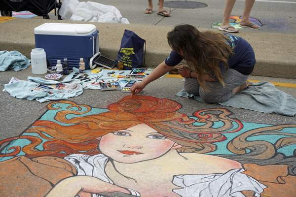 Courtesy Sue Sells Sue Sells photographed Megan Wiegand as she re-created a work by Alphonse Mucha for Fort Wayne Museum of Art's Chalk Walk on July 10 during Three Rivers Festival. Wiegand won in the category of reproduction from the Fort Wayne Museum of Art's collection.