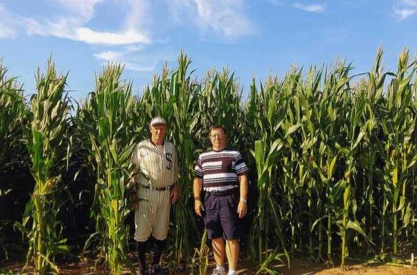 """Courtesy Frank Koehl Frank Koehl, right, of Fort Wayne poses on the """"Field of Dreams"""" movie set July 24 in Dyersville, Iowa. Koehl and his wife, Carol,traveled this summer, including a stop at Scott's Bluff National Monument nearGering, Nebraska, along the Oregon Trail."""