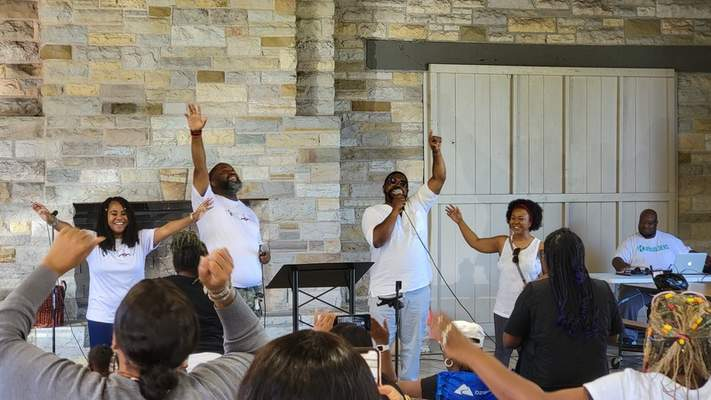 Courtesy John Paff On Aug. 15, Pastor Bryson Sharp, center left, of Kingdom Builders Church and Prophet Cedric Walker of Joshua's Temple Missionary Baptist Church celebrate the planned merger of their congregations.
