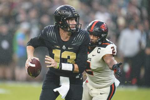 Oregon St Purdue Football Purdue quarterback Jack Plummer (13) is chase out of the pocket by Oregon State linebacker Andrzej Hughes-Murray (2) during the first half of an NCAA college football game in West Lafayette, Ind., Saturday, Sept. 4, 2021. (AP Photo/Michael Conroy) (Michael Conroy STF)