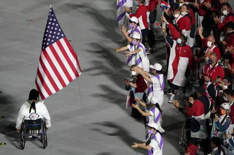 Tokyo Paralympics Closing Ceremony Associated Press The flag of the United States enters the stadium during the closing ceremony for the Paralympics at the National Stadium in Tokyo on Sunday. (Eugene HoshikoSTF)
