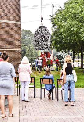 """""""There Are Rivers,""""a sculpture by Dale Enoch, is installed outside of the Fort Wayne Museum of Art along Main Street last month."""