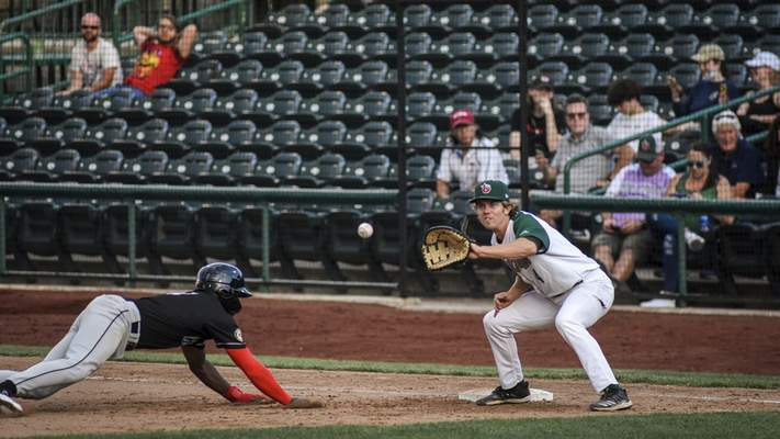 Mike Moore   The Journal Gazette TinCaps first baseman Chris Givin readies the catch in game one of Wednesday's doubleheader against Lansing.