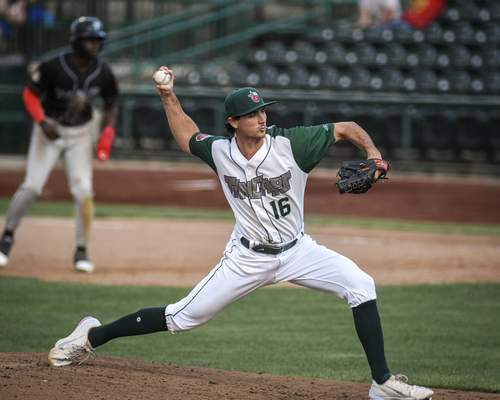 Mike Moore   The Journal Gazette TinCaps pitcher Sam Keating winds up for the pitch in the seventh inning against the Lansing in game one of a doubleheader at Parkview Field on Wednesday.