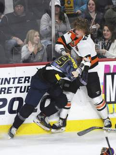 Justin A. Cohn | The Journal Gazette  The Komets' Drake Rymsha, right, fights the Toledo Walleye's Troy Loggins at the Huntington Center in Toledo, Ohio, in May 2020.