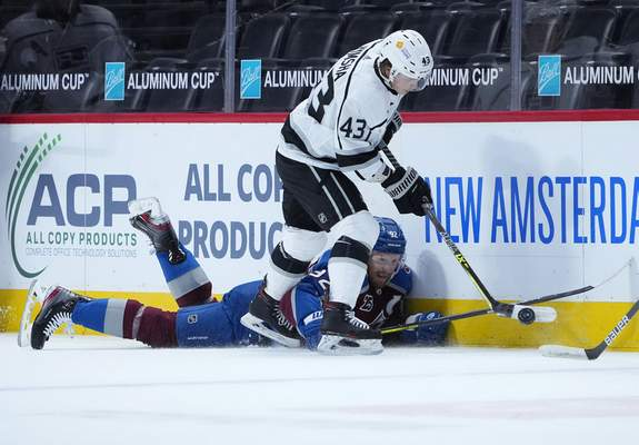 Associated Press  Drake Rymsha, top, in his NHL debut in May, steals the puck from the Colorado Avalanche's Gabriel Landeskog in Denver.