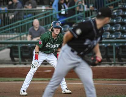 Mike Moore | The Journal Gazette TinCaps center fielder Robert Hassell III eyes Lansing pitcher Reid Birlingmair while leading off first base in the first inning at Parkview Field on Thursday.