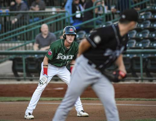 Mike Moore   The Journal Gazette TinCaps center fielder Robert Hassell III eyes Lansing pitcher Reid Birlingmair while leading off first base in the first inning at Parkview Field on Thursday.