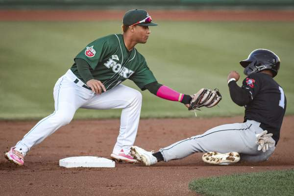 Mike Moore   The Journal Gazette  TinCaps shortstop Euribiel Angeles reaches for the tag as Lugnuts third baseman Cobie Vance slides into the base in the second inning at Parkview Field on Thursday.