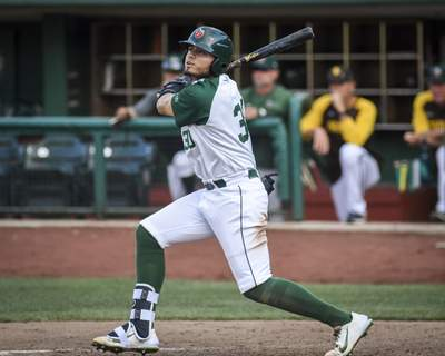 Mike Moore | The Journal Gazette TinCaps' Tirso Ornelas with a base hit in game one of Wednesday's doubleheader against Lansing.