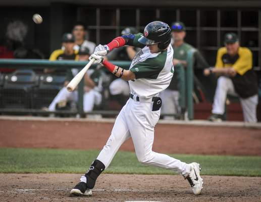 Mike Moore | The Journal Gazette TinCaps outfielder Robert Hassell III makes contact on Wednesday in game one of Wednesday's doubleheader against Lansing.