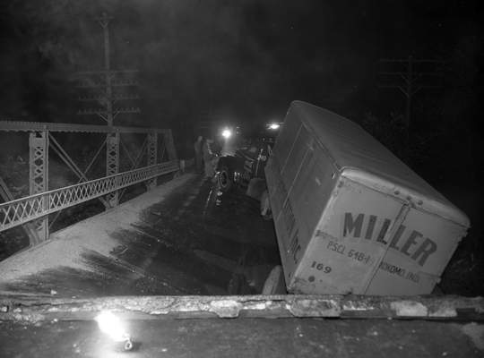 Oct. 17, 1947: Part of a bridge floor on US Highway 427 fell into a creek bed when a bridge support was struck by a transportation truck during an accident. (Journal Gazette file photo)