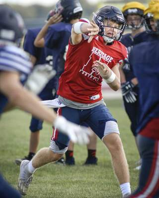 Mike Moore   The Journal Gazette Heritage will need less from quarterback Kobe Meyer after leaning more on the run game.