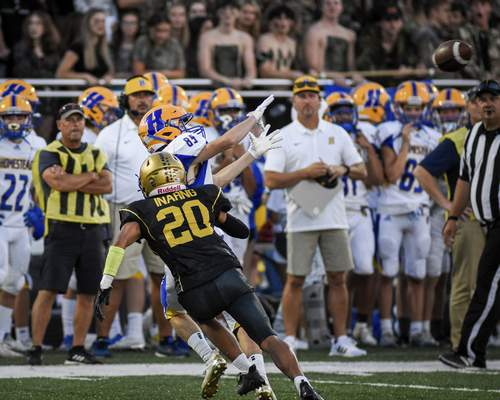 Mike Moore | The Journal Gazette Homestead wide receiver Mason Auxier goes up for a catch in the second quarter against Bishop Dwenger at Shields Field on Friday.