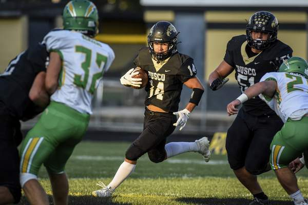 Mike Moore   The Journal Gazette Busco running back Ethan Hille runs the ball in the first quarter against Eastside on Friday.