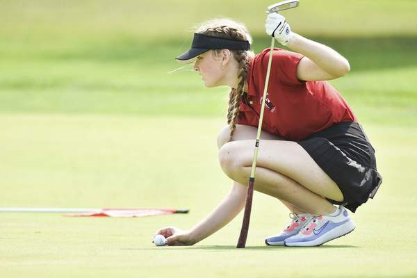 Katie Fyfe | The Journal Gazette Bishop Luers junior Helena Pyle prepares to putt on the green at the first hole during the SAC Girls Golf Tournament at Brookwood Golf Club on Saturday.