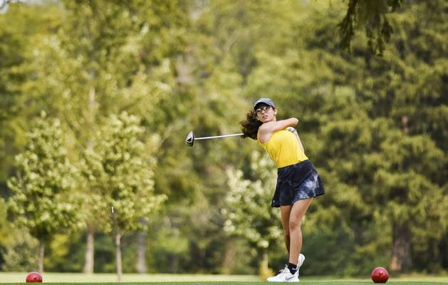 Katie Fyfe | The Journal Gazette Snider senior Mia Birkenbeul tees off at the second hole during the SAC Girls Golf Tournament at Brookwood Golf Club on Saturday.
