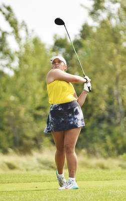 Katie Fyfe | The Journal Gazette Snider junior Lexi Matthias tees off at the fourth hole during the SAC Girls Golf Tournament at Brookwood Golf Club on Saturday.