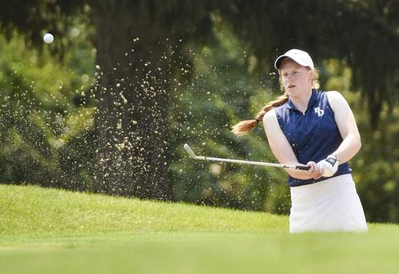 Katie Fyfe | The Journal Gazette Bishop Dwenger senior Bekah Landstoffer hits out of a sand trap onto the green at the third hole during the SAC Girls Golf Tournament at Brookwood Golf Club on Saturday.