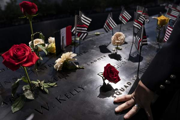 Associated Press A firefighter places his hand on the name engravings at the National September 11 Memorial & Museum in New York during ceremonies to commemorate the 20th anniversary of the Sept. 11 terrorist attacks.