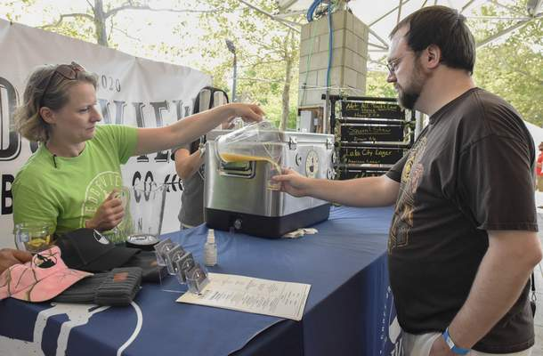 Michelle Davies | The Journal Gazette Zach Harder, of Fort Wayne, gets a Nitwit from Abby McLaren, owner of Ledgeview Brewing Co., of Warsaw, IN, at Saturday's annual Brewed IN the Fort Craft Beer Festival, celebrating locally crafted beers, ciders, food, and entertainment.