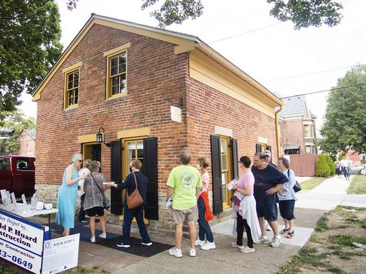 Katie Fyfe   The Journal Gazette People line up Saturday to tour the Mary Rockhill-Tyler house on Van Buren Street during the 39th Annual West Central Neighborhood Home & Garden Tour and ArtsFest.