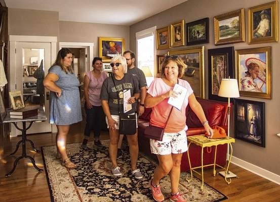 Katie Fyfe   The Journal Gazette People tour a Wayne Street home during the 39th annual West Central Neighborhood Home & Garden Tour and ArtsFest on Saturday. The tours continue from 11a.m. to 5 p.m. today.