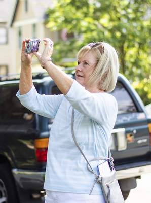 Katie Fyfe   The Journal Gazette Barbara Stauffer takes pictures of homes during the 39th Annual West Central Neighborhood Home & Garden Tour and ArtsFest on Saturday.